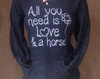 XL Women's equestrian horse lover fleece sweatshirt apparel. Raw edge neck line and a front kangaroo pocket.