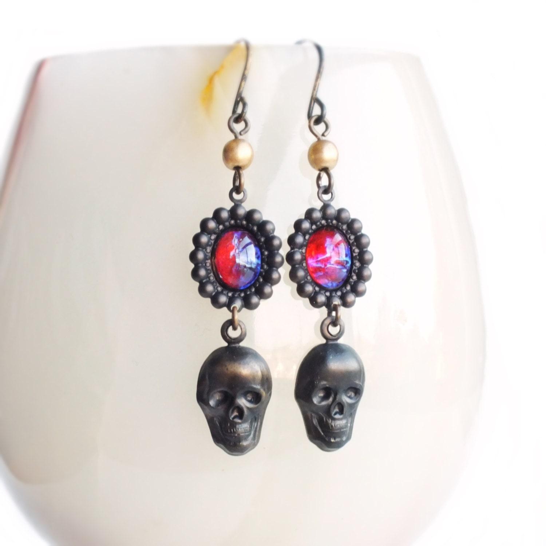 black skull earrings vintage dragons breath opal earrings