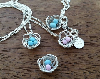 Custom hand made sterling silver mother's day bird nest pendant.
