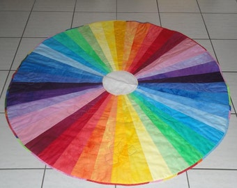 "Round baby-quilt or lap-rug  ""blaze of colours"""