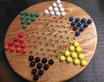 Chinese checker board with marbles