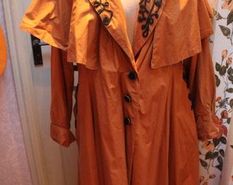 Burnt Orange Raincoat size 14/16 116a