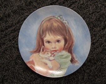"""Frances Hook """"So Cuddly"""" girl with kitten 7 and 1/2 inch plate. Number 0047"""