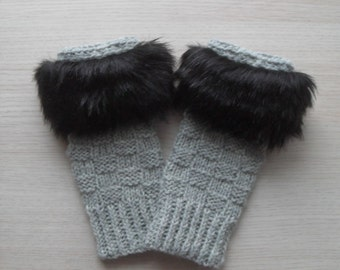 Women hand knitted gray fingerless gloves with faux fur trim