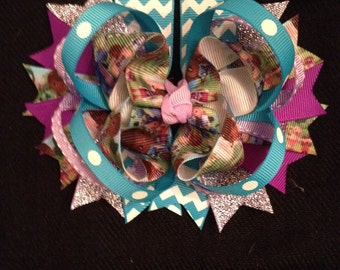Boutique hair bow with alligator clip on back.