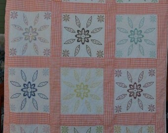 Vintage cross stitched quilt