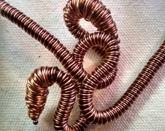 Copper wire coiled necklace.