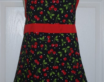 Adorable apron with cherry print in red/white and green on a black background