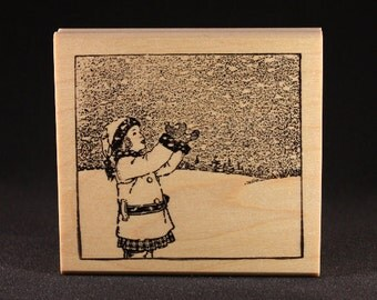 Girl Catching Snowflakes Ruber Art Stamp