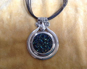 "Silver plate pendant on 18"" black rope necklace"