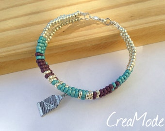 Bracelet adorned with rockeries beads and a silver charm - Friendship Bracelet.