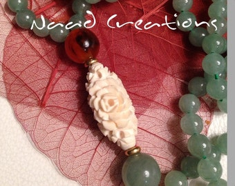 JAPA mala 7mmbsfera yellow gold 750 amber jade% Central Ivory inlaid with flowers measuring 3 cm height/width 1 cm,