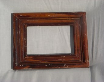 4 x 6 picture and 6 3/4 x 8 3/4 frame. Brown country like wooden frame