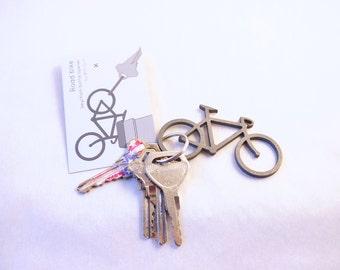 Road bike keychain bottle opener