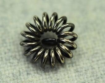 Silver spiral button