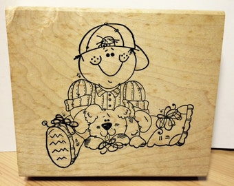 Boy Wearing Cap Sitting with Puppy on His Lap Rubber Stamp by Imaginations!