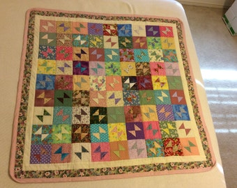 Baby quilt for girl. Ready to ship. Pinks, yellows, greens and purples. Item #107.