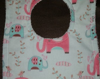 Lil Green Rhino's hand made bibs with towelling on the back. Super absorbent.