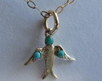 Vintage 9ct gold and turquoise swallow on a vintage 9ct gold chain