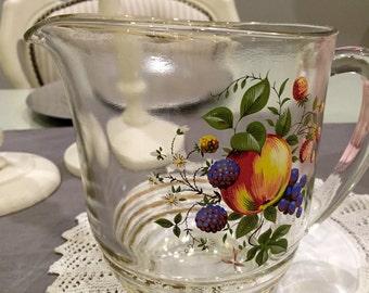 Retro vintage glass jug with fruit design