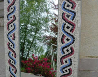 Mirror with mosaic decoration, a woven pattern.