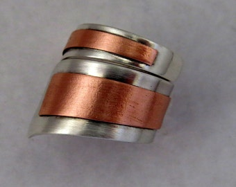 Ring in sterling silver with a sheet of brass or copper welded over. Adjustable