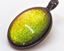 Her Green Eyes Flashed Red - green, orange, and red glitter flakie color shifting glitter pendant necklace