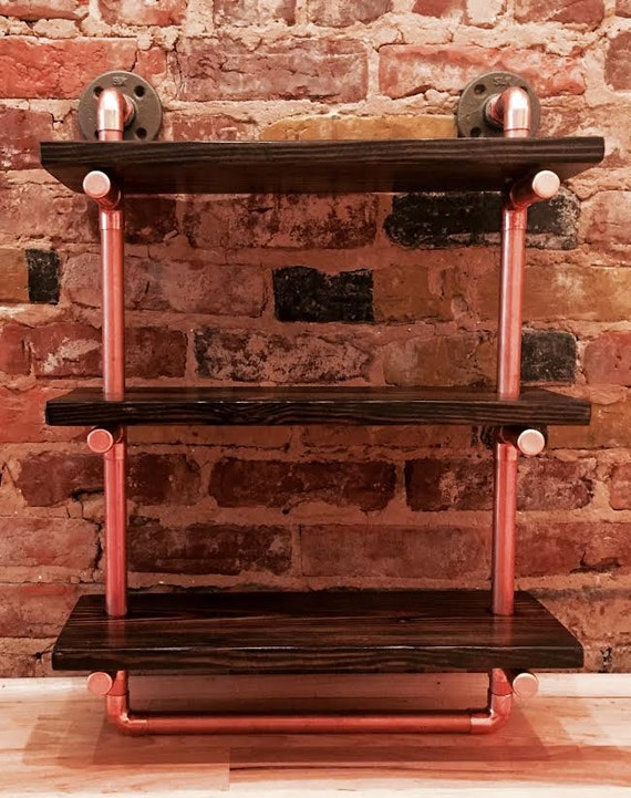 Reclaimed wood shelves with pipe