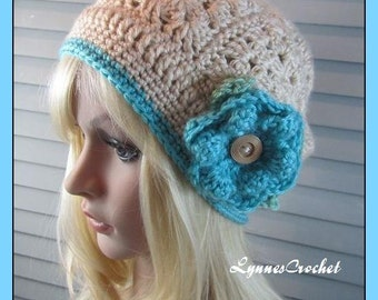 Crocheted Granny Square Hat with Aqua flower and trim. .