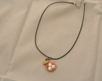 Bronze bird/ white eggs nest  necklace