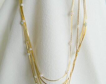 Multi-strand serpentine necklace