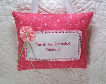 Pocket pillow thank you gift, door hanger pillow in pink fabric, ink print trimmed with white lace, pink polka dot ribbon flower hand beaded