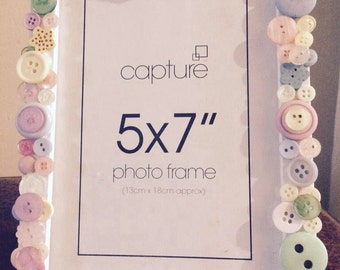Pink and purple, pastel coloured button photo frame.