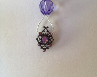22 inch  Purple and Lavender beaded necklace with Victorian style pendant
