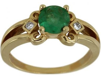 Emerald Ring In 14k Yellow Gold With Diamond Accents And A Split Shank Design