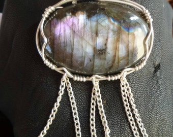 Muticolored labradorite wire wrapped in fine silver.  Made in Australia