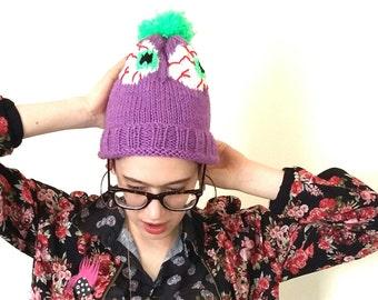 Zombie eyeball hat. Hand knitted purple zombie eye bobble hat