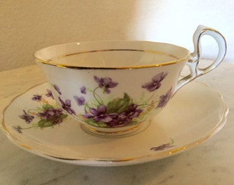 Antique Woodlands Genuine Bone China, Tea Cup And Saucer Set, Made In England. Flowered And Gold Trim.