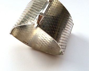 Sterling silver patterned triangle cuff