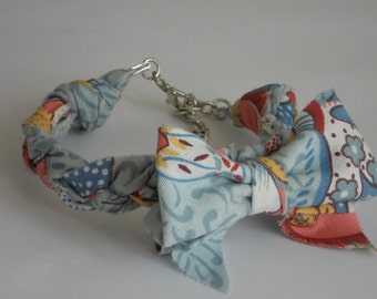 Collar for cats or small dogs in light blue and pink strap
