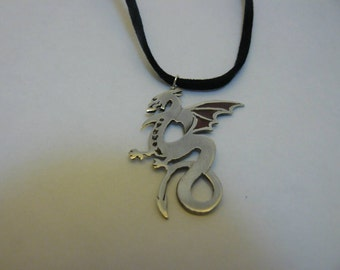 Sterling silver dragon with wings picked out in red/brown enamel