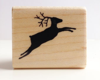 hand carved jumping reindeer rubber stamp