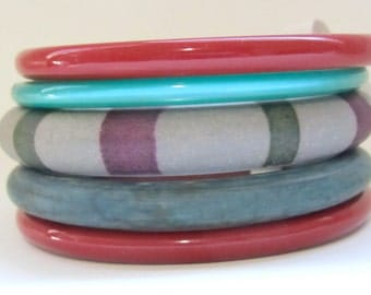 Vintage Bangle Set: Stack of five lucite, moonglow, plastic bracelets - red, green, white - frosted and opaque jewelry