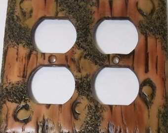 Bark of a tree double outlet cover, wood look with moss