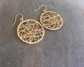 Classic gold woven hoop earrings.