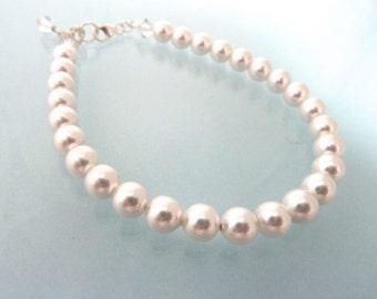 Glossy bridal white Swarovski pearl bracelet with sterling silver clasp
