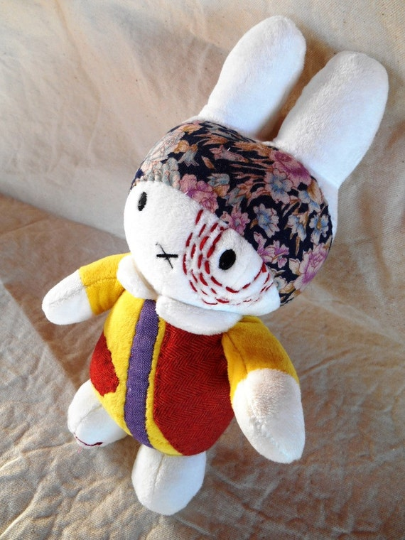 "Soft Toy re-covered ""Bunny white"" fabric patches and cotton thread"