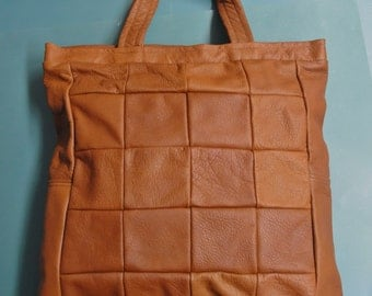 Very useful small highquality new/unused tote bag/handbag of strong real natural organic light brown skin/leather