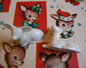 two little white sitting deer figurines