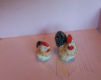 tiny colorful chicken figurines